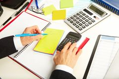 Businesswoman working with calculator Royalty Free Stock Images