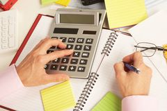 Businesswoman working with calculator Stock Images