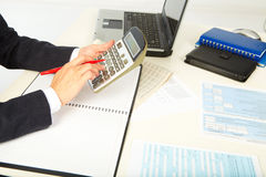 Businesswoman working with calculator Stock Image