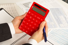 Businesswoman working with calculator Stock Photos