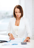 Businesswoman working with calculator in office Royalty Free Stock Photos