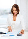 Businesswoman working with calculator in office Royalty Free Stock Photography