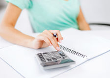 Businesswoman working with calculator in office Royalty Free Stock Photo