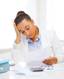 Businesswoman working with calculator in office Royalty Free Stock Images