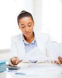 Businesswoman working with calculator in office Stock Photo