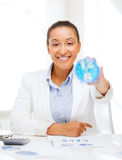 Businesswoman working with calculator in office Stock Images