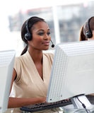Businesswoman working in a call center Stock Photo