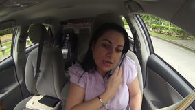 Businesswoman working in the car stock video footage