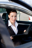 Businesswoman working in car Stock Image