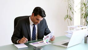 Businesswoman working with charts stock footage