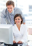 Businesswoman working at a computer Stock Images