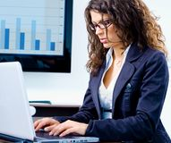 Businesswoman working on computer Stock Photos