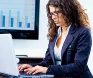 Businesswoman working on computer Stock Photos