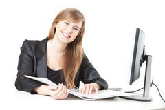 Businesswoman working with computer and documents Royalty Free Stock Photography