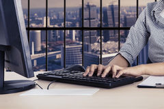 Businesswoman working with a computer Royalty Free Stock Image
