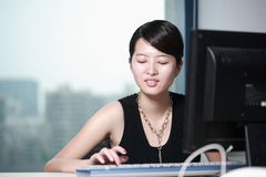 Businesswoman working with computer in office Stock Photo