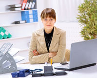 Businesswoman working at desk Stock Images