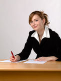 Businesswoman working at a desk Royalty Free Stock Photography