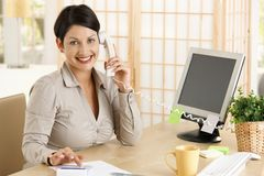 Businesswoman working at desk Stock Photos