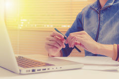 Businesswoman Working at Desk,Businesswoman write something abou Royalty Free Stock Images