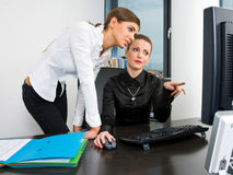 Businesswoman working at desk computer Stock Images
