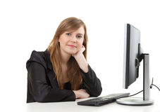 Businesswoman working at the desk with a computer Royalty Free Stock Photo