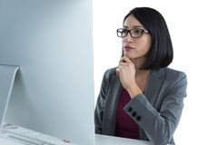 Businesswoman working on desktop pc Stock Images