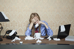 Businesswoman working despite illness Stock Photography