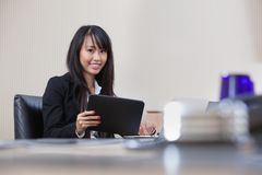 Businesswoman working on digital tablet Royalty Free Stock Photography