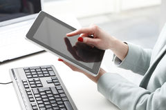 Businesswoman working on digital tablet. Stock Images