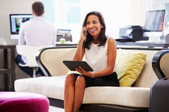 Businesswoman Working On Digital Tablet In Hotel Lobby Stock Photography