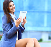 Businesswoman working on digital tablet outdoor Stock Images