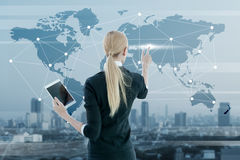 Businesswoman working on digital virtual screen Royalty Free Stock Image