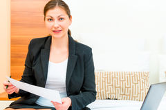 Businesswoman working with documents in the hotel Stock Photography
