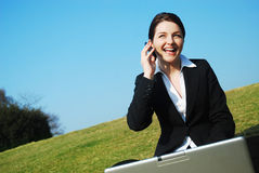 Businesswoman working in field Stock Image