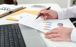 Businesswoman working on financial graphs Stock Images