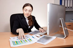Businesswoman working with financial report Royalty Free Stock Images
