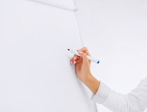 Businesswoman working with flip board in office Stock Photography