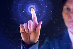 Businesswoman working in futuristic cyberspace hightech environment. Hand pushing interface button royalty free stock photography
