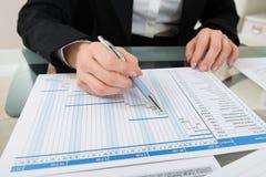 Businesswoman Working On Gantt Chart Stock Photography