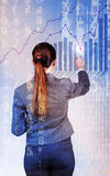 The businesswoman working with graph in business concept Stock Image