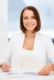 Businesswoman working with graphs in office Stock Photos