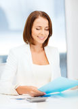Businesswoman working with graphs in office Stock Photography