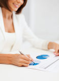 Businesswoman working with graphs in office Stock Images