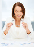 Businesswoman working with graphs in office Royalty Free Stock Photography