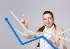 Businesswoman working with growth graph on grey background Stock Photos