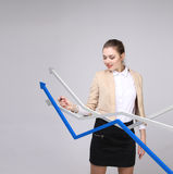 Businesswoman working with growth graph on grey background Royalty Free Stock Photography