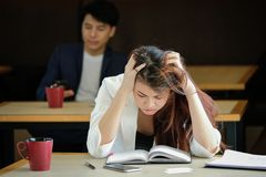 Businesswoman working have a headache work out working Stock Image