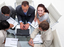 Businesswoman working with her colleagues Royalty Free Stock Photo