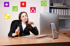 Businesswoman working on her computer Stock Image